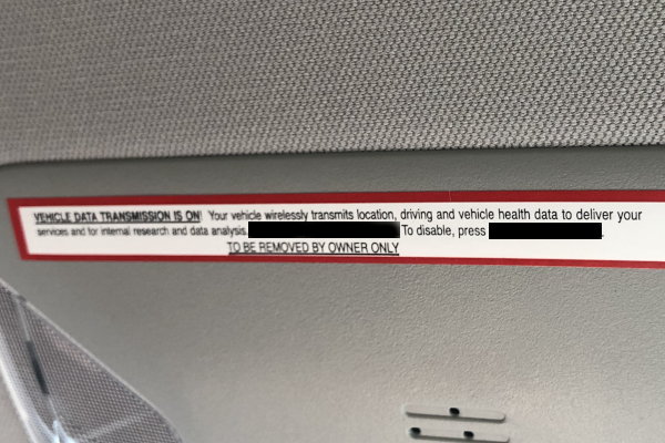 Picture of a privacy disclaimer in an automobile to illustrate involuntary consent.